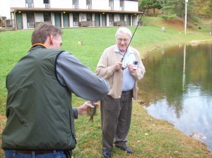 Caregiver and client fishing
